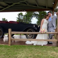 An antique car and a bride and groom at House Plantation