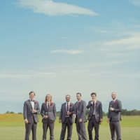 Groomsmen on the grounds of House Plantation