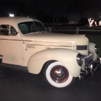 Antique cars and tree lit drive at House Plantation