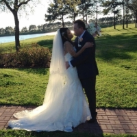bride and groom with lake side views in Houston.JPG