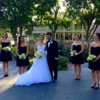 bridesmaids and wedding couple in front of house plantation