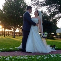 september outdoor wedding aligned with white rose petals