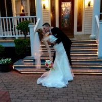 wedding kiss on the front steps in april.jpg