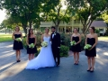 bridesmaids and wedding couple in front of House Estate