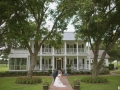 wedding kiss in front of House Estate