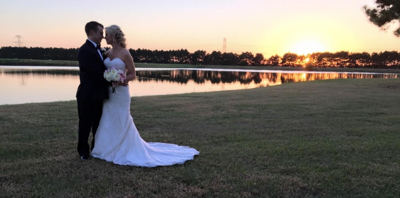 wedding couple by the lake in october at House Plantation