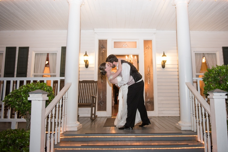 wedding kiss pics at front of mansion by Eric & Jenn Photography
