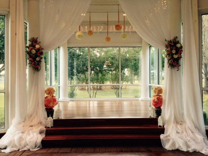 indoor wedding altar with flowers