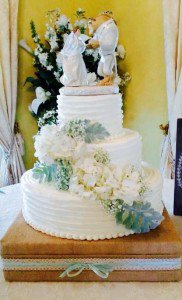 wedding cake with beauty and the beast topper